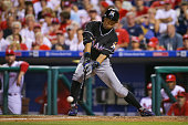 Ichiro Suzuki of the Miami Marlins fouls off a pitch while pinch hitting in the eighth inning during a game against the Philadelphia Phillies at...
