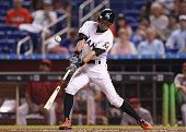 Ichiro Suzuki of the Miami Marlins gets a hit during the fifth inning of the game at Marlins Park on May 18 2015 in Miami Florida This was Ichiro's...