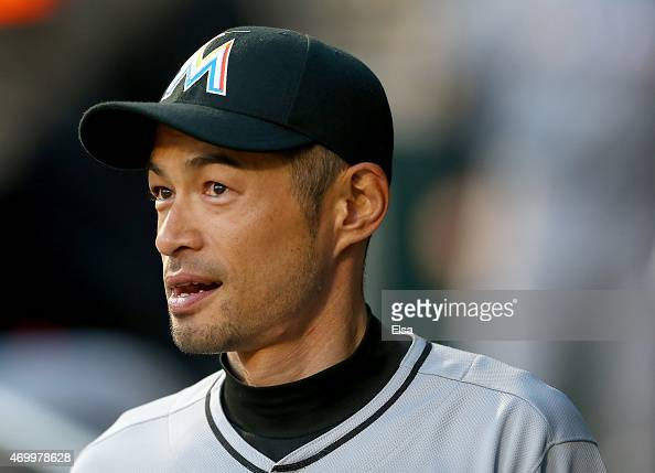 Ichiro Suzuki of the Miami Marlins gets ready for the game against the New York Mets with his teammates in the dugout on April 16 2015 at Citi Field...
