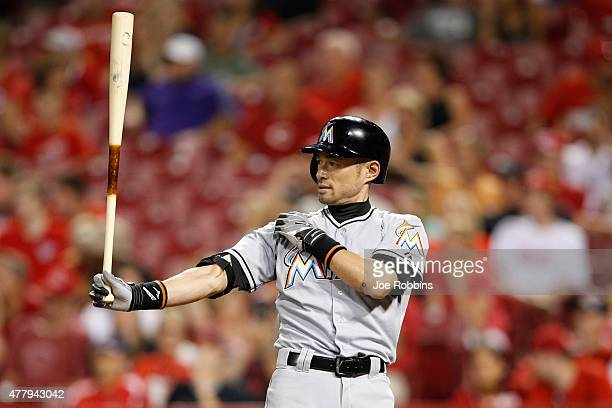 Ichiro Suzuki of the Miami Marlins gets ready to pinch hit in the ninth inning against the Cincinnati Reds at Great American Ball Park on June 20...