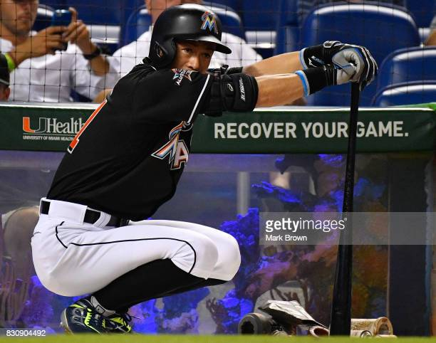 Ichiro Suzuki of the Miami Marlins gets ready to pinch hit in the sixth inning during the game between the Miami Marlins and the Colorado Rockies at...