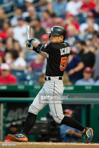 Ichiro Suzuki of the Miami Marlins grounds into a double play in the second inning during a game against the Washington Nationals at Nationals Park...