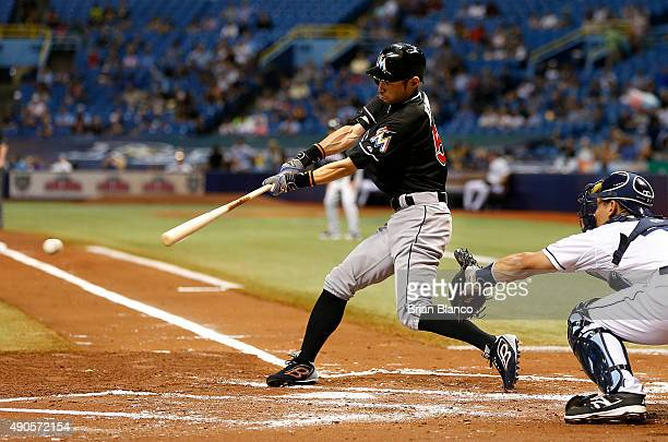 Ichiro Suzuki of the Miami Marlins grounds out in front of catcher Luke Maile of the Tampa Bay Rays to end the top of the second inning of a game on...