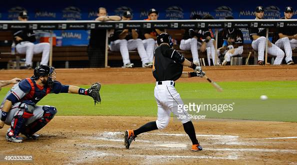 Ichiro Suzuki of the Miami Marlins grounds out in the seventh inning of play in front of AJ Pierzynski of the Atlanta Braves at Marlins Park on...