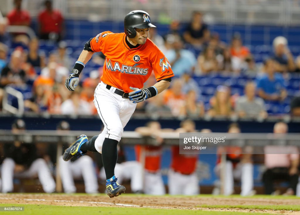 Ichiro Suzuki #51 of the Miami Marlins grounds out pinch hitting in the eighth inning in front of Jorge Alfaro #38 of the Philadelphia Phillies at Marlins Park on September 3, 2017 in Miami, Florida.