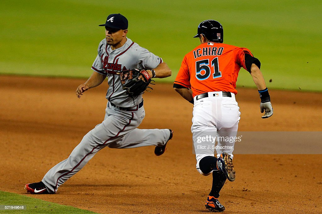 <a gi-track='captionPersonalityLinkClicked' href=/galleries/search?phrase=Ichiro+Suzuki&family=editorial&specificpeople=201556 ng-click='$event.stopPropagation()'>Ichiro Suzuki</a> #51 of the Miami Marlins heads for second base around <a gi-track='captionPersonalityLinkClicked' href=/galleries/search?phrase=Kelly+Johnson+-+Jugador+de+b%C3%A9isbol&family=editorial&specificpeople=4520789 ng-click='$event.stopPropagation()'>Kelly Johnson</a> #24 of the Atlanta Braves in the 7th inning at Marlins Park on April 17, 2016 in Miami, Florida.