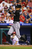 Ichiro Suzuki of the Miami Marlins hits a fly ball while pinch hitting in the eighth inning during a game against the Philadelphia Phillies at...