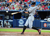 Ichiro Suzuki of the Miami Marlins hits a ninth inning triple against the Atlanta Braves at Turner Field on August 9 2015 in Atlanta Georgia