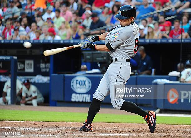 Ichiro Suzuki of the Miami Marlins hits a ninth inning triple against the Atlanta Braves at Turner Field on August 9 2015 in Atlanta Georgia