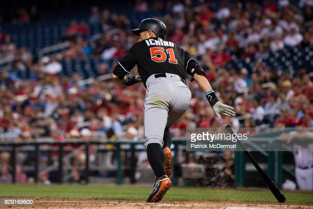 Ichiro Suzuki of the Miami Marlins hits a RBI single scoring Derek Dietrich in the fourth inning during a game against the Washington Nationals at...