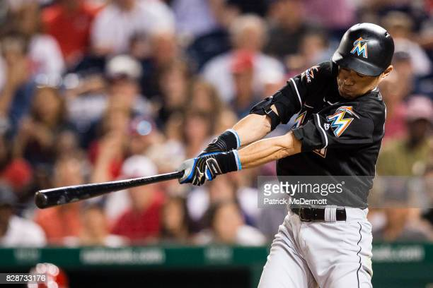 Ichiro Suzuki of the Miami Marlins hits a single to center in the seventh inning during a game against the Washington Nationals at Nationals Park on...