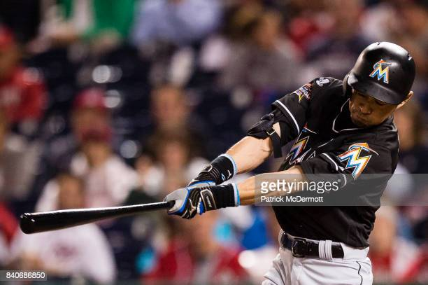 Ichiro Suzuki of the Miami Marlins hits a single to center in the seventh inning against the Washington Nationals at Nationals Park on August 29 2017...