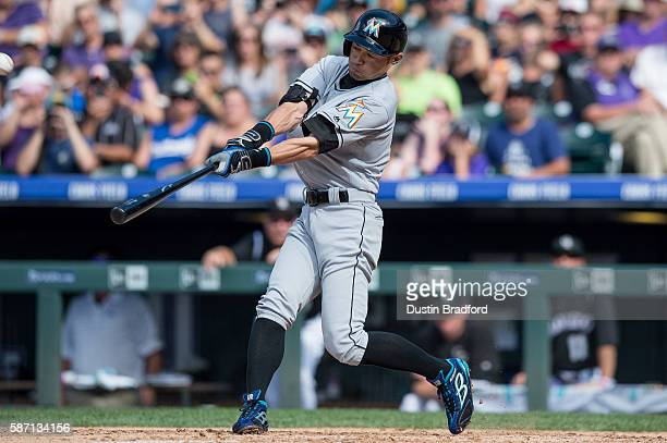 Ichiro Suzuki of the Miami Marlins hits a triple off of Chris Rusin of the Colorado Rockies for the 3000th hit of his major league career in the...
