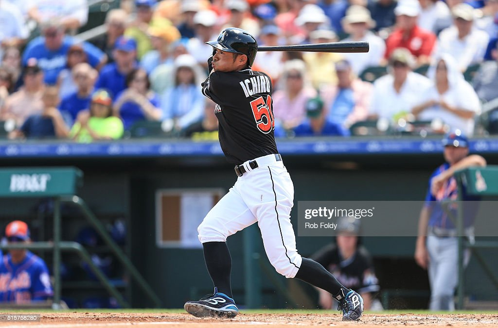 Ichiro Suzuki #51 of the Miami Marlins hits an RBI single during the fourth inning of the spring training game against the New York Mets on March 15, 2016 in Jupiter, Florida.