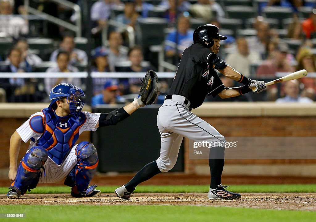 Ichiro Suzuki of the Miami Marlins is called for his third strike on this swing as Travis d'Arnaud of the New York Mets catches in the sixth inning...