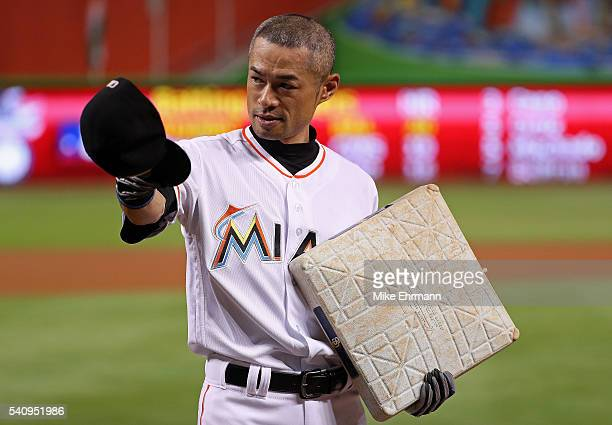 Ichiro Suzuki of the Miami Marlins is presented with the base celebrating his 4257th hit between Japan and MLB during a game against the Colorado...