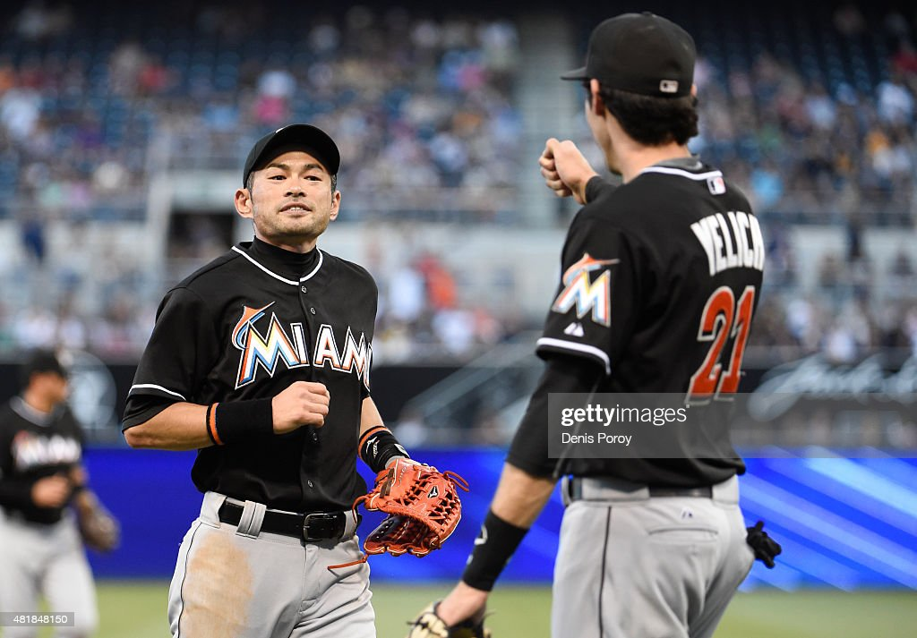 <a gi-track='captionPersonalityLinkClicked' href=/galleries/search?phrase=Ichiro+Suzuki&family=editorial&specificpeople=201556 ng-click='$event.stopPropagation()'>Ichiro Suzuki</a> #51 of the Miami Marlins, left, is congratulated by <a gi-track='captionPersonalityLinkClicked' href=/galleries/search?phrase=Christian+Yelich&family=editorial&specificpeople=9527291 ng-click='$event.stopPropagation()'>Christian Yelich</a> #21 after making a catch on a ball hit by Matt Kemp #27 of the San Diego Padres during the first inning of a baseball game at Petco Park July 24, 2015 in San Diego, California.