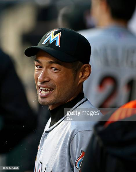 Ichiro Suzuki of the Miami Marlins looks on before game against the New York Mets with his teammates in the dugout on April 16 2015 at Citi Field in...