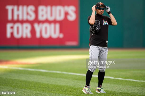 Ichiro Suzuki of the Miami Marlins looks on during batting practice before a game against the Washington Nationals at Nationals Park on August 9 2017...