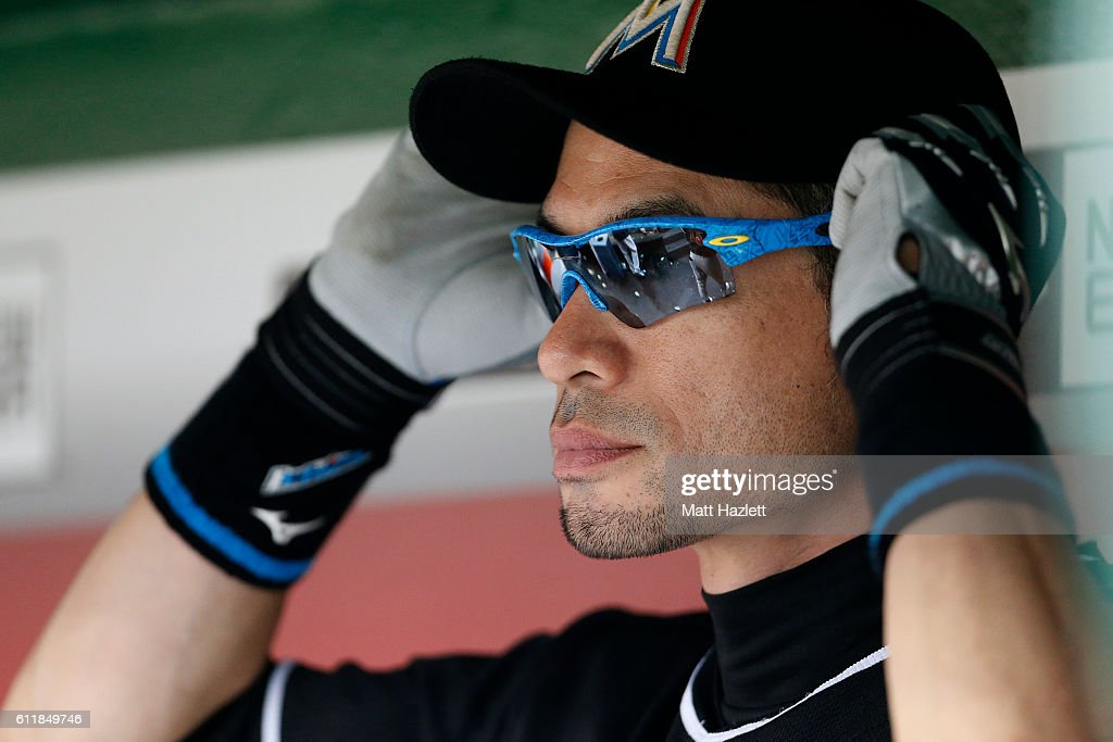 Ichiro Suzuki #51 of the Miami Marlins looks on from the dug out in the sixth inning against the Washington Nationals at Nationals Park on October 1, 2016 in Washington, DC.