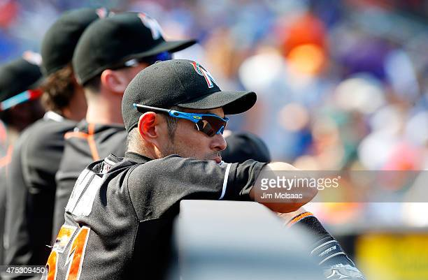 Ichiro Suzuki of the Miami Marlins looks on from the dugout during the first inning against the New York Mets at Citi Field on May 30 2015 in the...