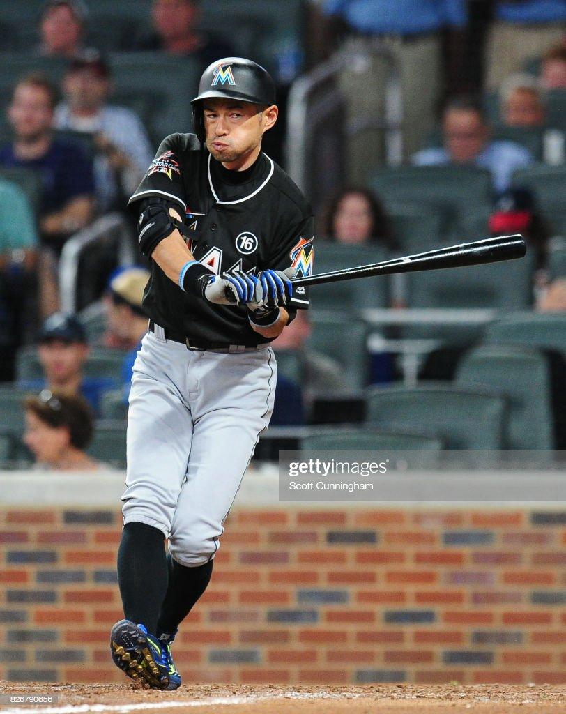 Ichiro Suzuki #51 of the Miami Marlins looks to avoid an eighth inning pitch against the Atlanta Braves at SunTrust Park on August 5, 2017 in Atlanta, Georgia.