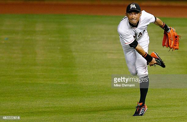 Ichiro Suzuki of the Miami Marlins makes a throw home during a game against the Washington Nationals at Marlins Park on July 28 2015 in Miami Florida