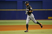 Ichiro Suzuki of the Miami Marlins makes his way back to the dugout after flying out to right field during the seventh inning of a game against the...