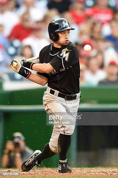 Ichiro Suzuki of the Miami Marlins misses a pitch in the seventh inning during a baseball game against the Washington Nationals at Nationals Park on...