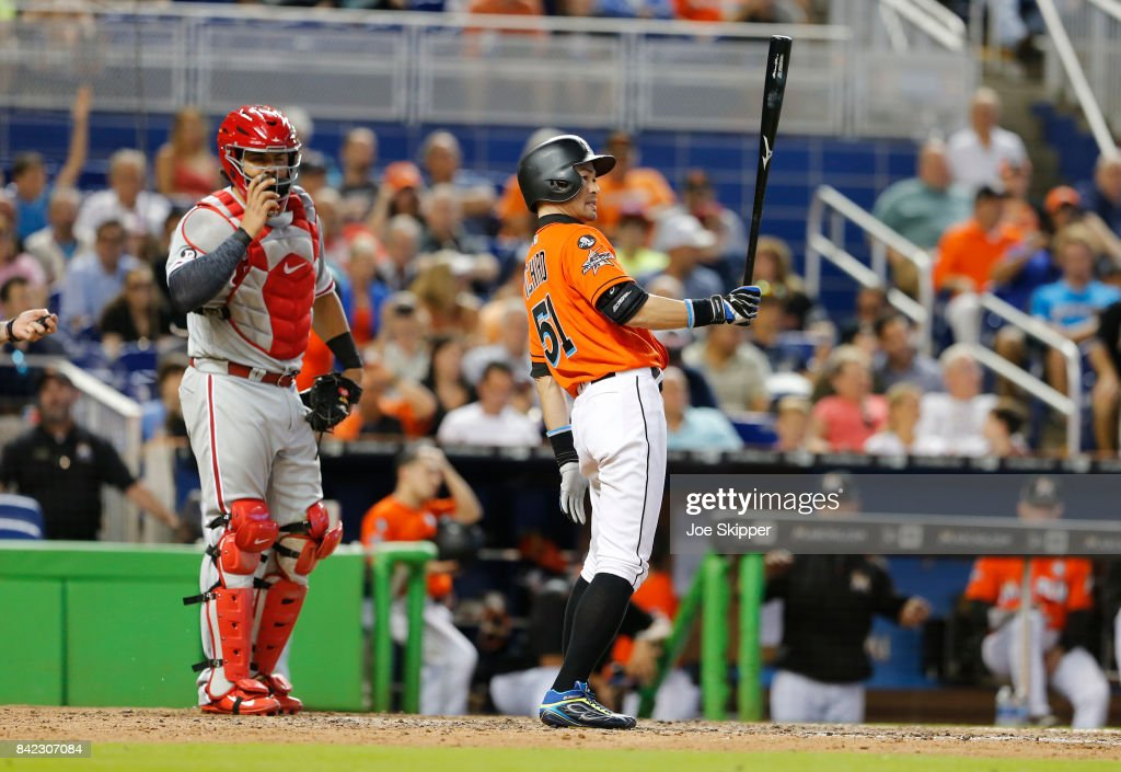 Ichiro Suzuki #51 of the Miami Marlins pinch hitting in the eighth inning in front of Jorge Alfaro #38 of the Philadelphia Phillies at Marlins Park on September 3, 2017 in Miami, Florida.