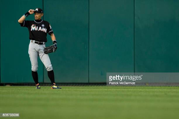 Ichiro Suzuki of the Miami Marlins plays center field in the second inning during a game against the Washington Nationals at Nationals Park on August...