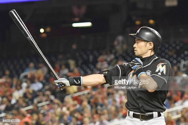 Ichiro Suzuki of the Miami Marlins prepares for pitch in the fifth inning during a baseball game against the Washington Nationals at Nationals Park...