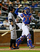 Ichiro Suzuki of the Miami Marlins reacts after he struck out as Travis d'Arnaud of the New York Mets defends on April 18 2015 at Citi Field in the...