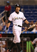 Ichiro Suzuki of the Miami Marlins reacts after striking out during the eighth inning of the game against the Arizona Diamondbacks at Marlins Park on...