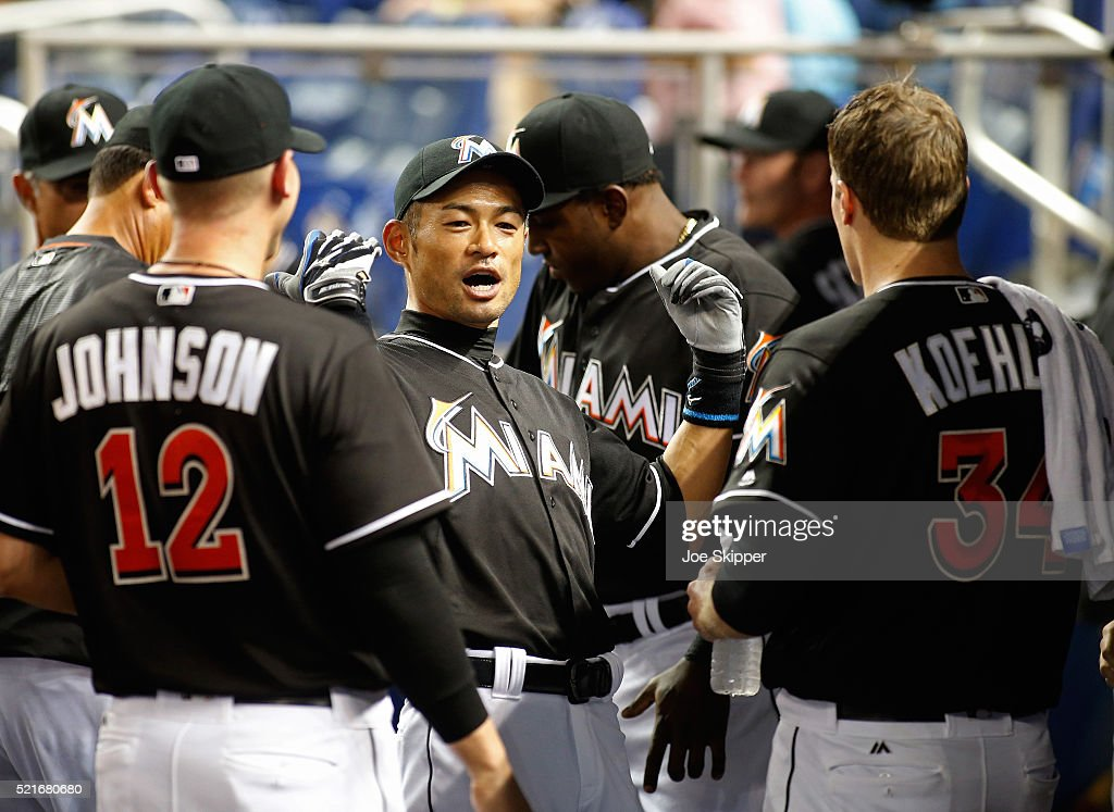 Ichiro Suzuki of the Miami Marlins reacts in the dugout before the Marlins played against the Atlanta Braves at Marlins Park on April 16 2016 in...