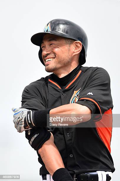 Ichiro Suzuki of the Miami Marlins reacts to a base hit during the second inning of a spring training game against the New York Mets at Roger Dean...