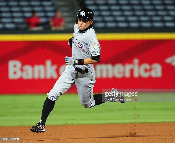 Ichiro Suzuki of the Miami Marlins rounds second base to score an eighth inning run against the Atlanta Braves at Turner Field on August 31 2015 in...