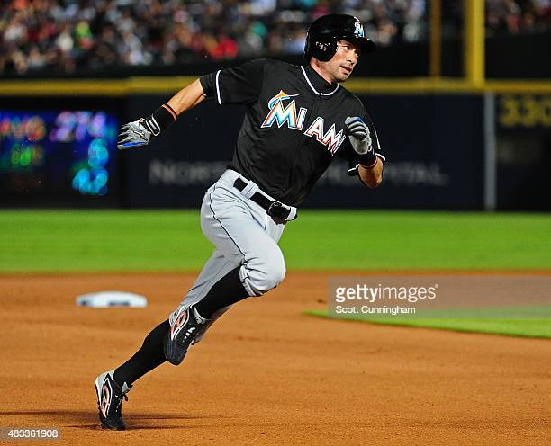 Ichiro Suzuki of the Miami Marlins rounds the bases to score a seventh inning run against the Atlanta Braves at Turner Field on August 7 2015 in...