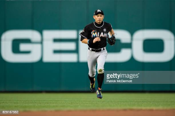 Ichiro Suzuki of the Miami Marlins runs back to the dugout after the second inning during a game against the Washington Nationals at Nationals Park...