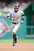 Ichiro Suzuki of the Miami Marlins runs the bases and scores in the first inning against the Washington Nationals at Nationals Park on August 30 2015...
