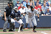 Ichiro Suzuki of the Miami Marlins runs to first base after grounding out in the infield during the eighth inning against the Milwaukee Brewers at...