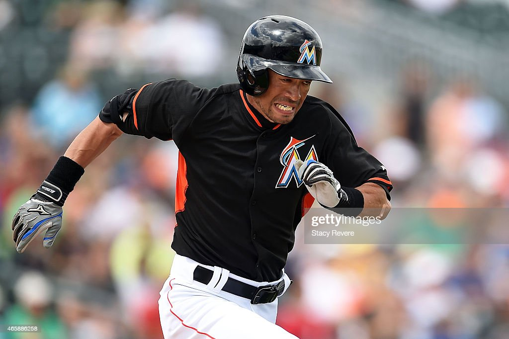 Ichiro Suzuki #51 of the Miami Marlins runs to first base during the fourth inning of a spring training game against the New York Mets at Roger Dean Stadium on March 11, 2015 in Jupiter, Florida.