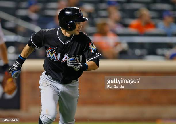 Ichiro Suzuki of the Miami Marlins runs to first base during the eighth inning against of the New York Mets in a game at Citi Field on September 1...