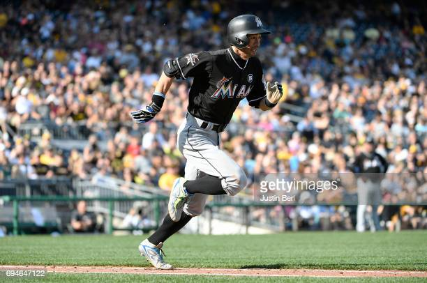 Ichiro Suzuki of the Miami Marlins runs to first base in the fifth inning during the game against the Pittsburgh Pirates at PNC Park on June 10 2017...