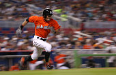 Ichiro Suzuki of the Miami Marlins runs to first in the third inning during a game against the Washington Nationals at Marlins Park on April 26 2015...