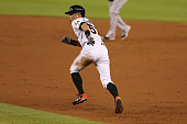 Ichiro Suzuki of the Miami Marlins runs to second base during the third inning of the game against the New York Yankees at Marlins Park on June 15...
