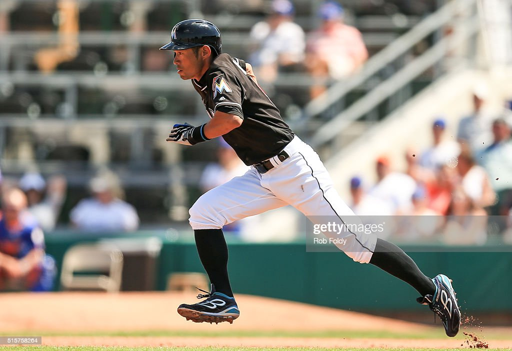 Ichiro Suzuki #51 of the Miami Marlins runs to second base during the fourth inning of the spring training game against the New York Mets on March 15, 2016 in Jupiter, Florida.