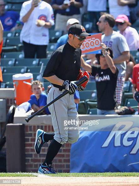 Ichiro Suzuki of the Miami Marlins runs to the dugout from the batting cage under right field before the Marlins take on the Chicago Cubs at Wrigley...
