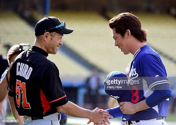 Ichiro Suzuki of the Miami Marlins shakes hands with Kenta Maeda of the Los Angeles Dodgers before the game at Dodger Stadium on April 25 2016 in Los...