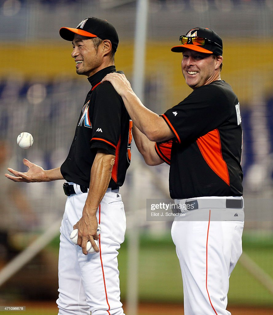 Ichiro Suzuki #51 of the Miami Marlins shares a laugh with Manager Mike Redmond #11 during batting practice prior to the start of the game against the Washington Nationals. Ichiro Suzuki is tied with Sadaharu Oh for the most runs scored by a Japanese player and needs one run for the record at Marlins Park on April 25, 2015 in Miami, Florida.